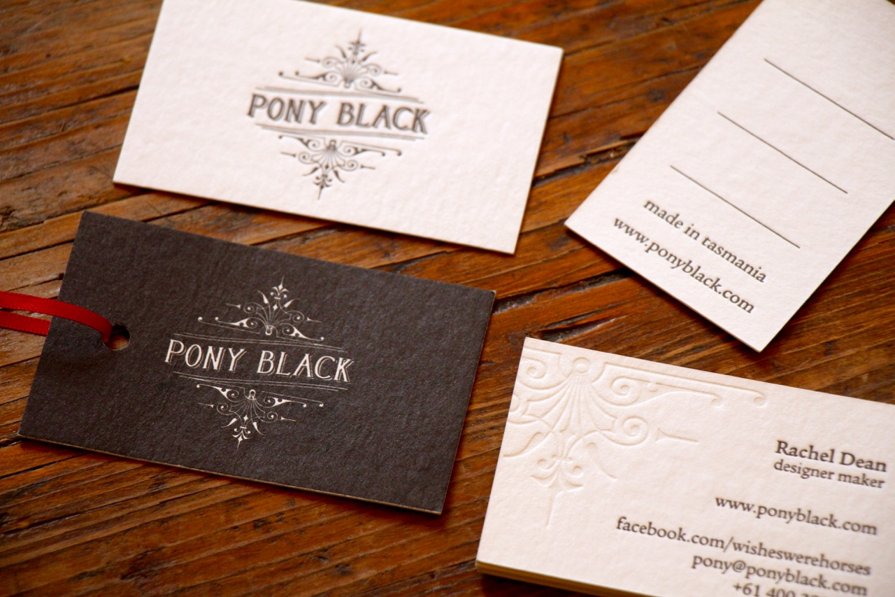 Business cards and swing tags designed for Pony Black by Brave Agency